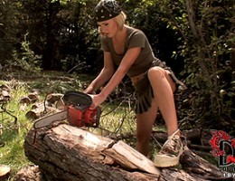 Hot blonde fucking her ass with the end of an axe outdoors