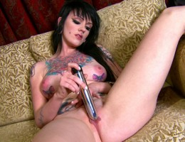 horny goth babe masturbates with a big toy until she creams