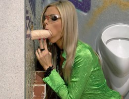Cutie giving head to a fake cock in a big public toilet