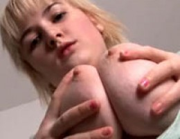 Big breasted blonde stripping and peeing