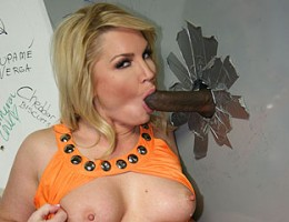 Flower Tucci sucks big black cock