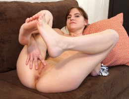 Horny coed Mila Lee is a little shy about showing off her delectable breasts, but the lusty amateur can be convinced. Once she takes off her shirt and pants, she finds herself eager to press a hand to her bald snatch and show us how she likes her clit fon