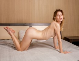Waiting for her lover to join her in bed, lusty Juliya takes her time running her hands all over her tight body. She undresses slowly, squeezing her tits as her bra comes off and cupping her bottom as she loses her panties. This hot blonde is all revved u