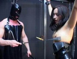 bound sexy latex slut gets whipped by masked master