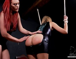 Carol receives a very hot spanking by awesome redhead Paige