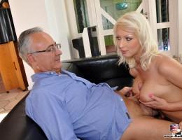 Horny blonde jerks his big boner with her stunning boobies