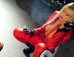 Blonde motorcycle fan in leather gets a double penetration