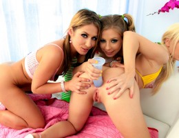 3 girls playing with dildo, sticking it in each others asses