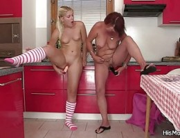 Pierced mom playing toys with teen