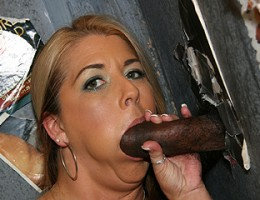 Blonde MILF sucks off black dick in gloryhole