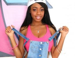 Black babe Brittney White in overalls