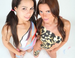 Two petite 18yo teens body painting each other