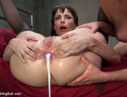 Anal fisting, strap-on, and double stuffing with two dommes.