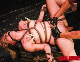 Trussed and tied with rope like a Christmas roast, no body part is off limits for Lily Ligotage?s cruel master and his evil bag of tricks. A ball gag is necessary to muffle the screams this cute and curvy girl next door type makes as she is toyed, throat