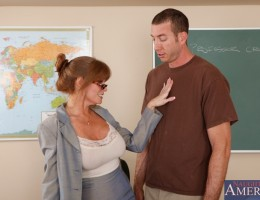 Busty redhead teacher Darla Crane has hot sex on her desk with one of her students.
