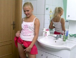 Tiny teen toying her thight juicy pussy in the bathroom