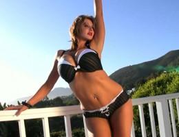 Brandy Robbins poses in fancy tux lingerie