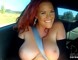 Gorgeous redhead Paige exposing her boobs in sexy sportcar