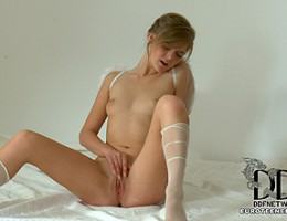 Naughty little angel Audrey shows us her nicely shaven pussy