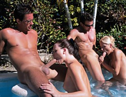 Blonde and Brunette fucks hard in a foursome out by the pool