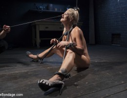 Holly Heart suffers through extreme torment and immobilizing bondage. Her reward for her suffering comes in the form of getting fucked in the ass.