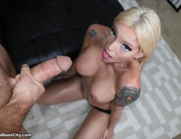 Busty blonde Bella stroking a monster-sized cock of Brad who protect her